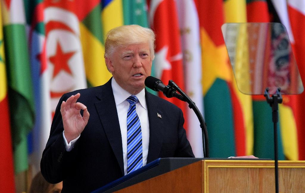 """US President Donald Trump speaks at Arab Islamic American Summit in Riyadh on May 21, 2017, calling on all countries to work together to isolate Iran """"until the Iranian regime is willing to be a partner for peace"""" (AFP Photo/MANDEL NGAN)"""