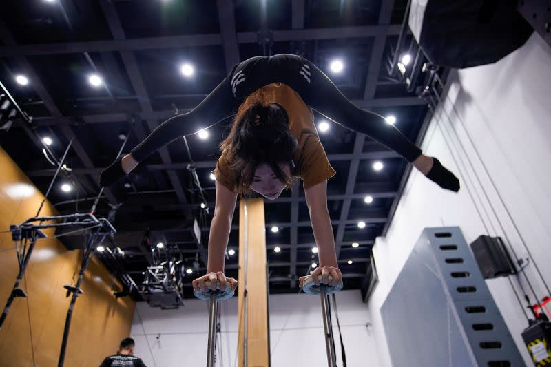 """A performer trains for the Cirque du Soleil """"The Land of Fantasy"""" show in Hangzhou"""