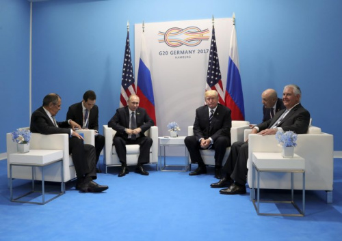 President Trump, third right, Secretary of State Rex Tillerson, right, Russian President Vladimir Putin, third left, and Foreign Minister Sergei Lavrov, left.