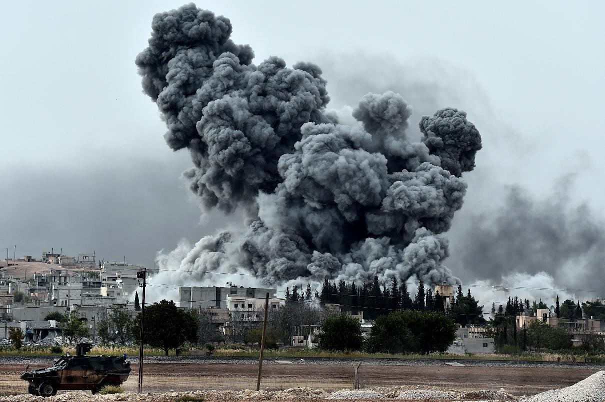 Smoke rises after an air strike on the Syrian town of Kobane, as seen from the Turkish border village of Mursitpinar, on October 12, 2014