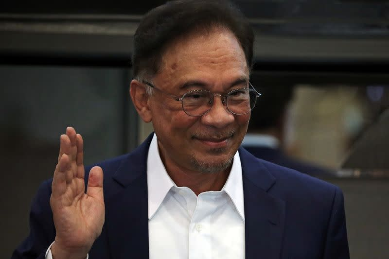 Malaysia opposition leader Anwar Ibrahim waves after a news conference in Kuala Lumpur