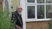 Corbyn leaves his house saying 'good morning' to the press