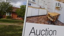 Home sales rise while prices dip slightly