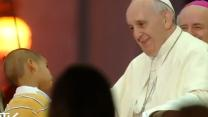 Adorable Little Boy Joins the Pope on Stage