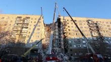 Several dead and many trapped in Russian apartment building gas blast
