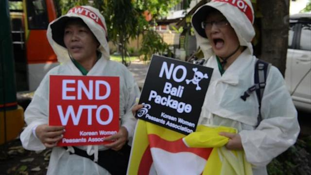 Activists protest at WTO conference in Bali
