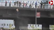 Pro-Morsi protesters jump from bridge to avoid gunfire