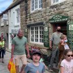 Crowds of holidaymakers flock to Cornwall despite coronavirus warnings