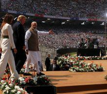 Trump heaps praise on India's Modi in packed stadium