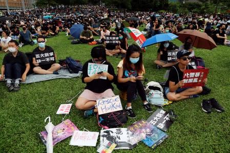 People take part in a general strike at Tamar Park in Hong Kong