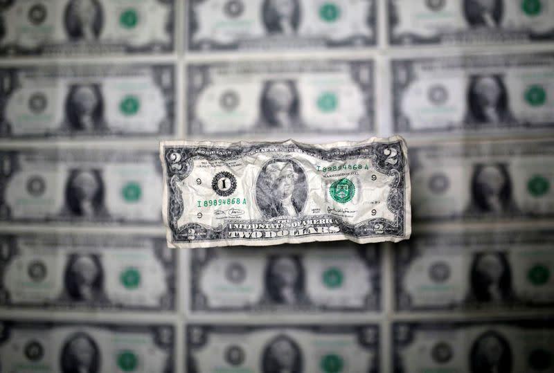 Surging dollar holds near six-week high as virus fears return