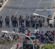 Myanmar police deploy early to crank up pressure on protests