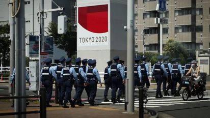 Olympics-Organisers probe drinking incident as Tokyo sizzles
