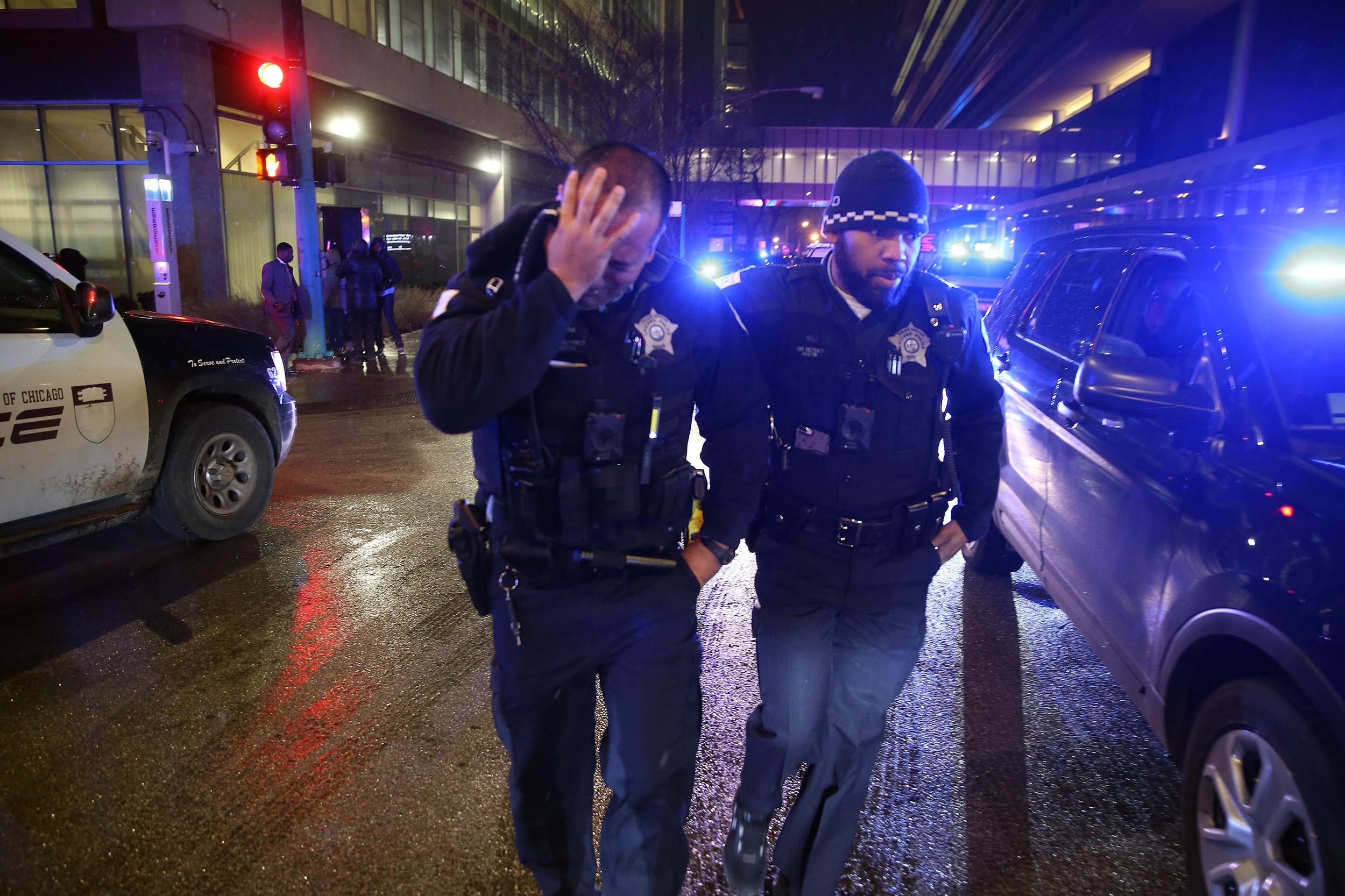 Chicago police comfort one another as they leave the University of Chicago Medical Center Monday, Nov. 19, 2018 to join a procession accompanying an ambulance bearing the body of Officer Samuel Jimenez, who was shot and killed at a separate South Side hospital earlier Monday. (Chris Walker/Chicago Tribune/TNS via Getty Images)