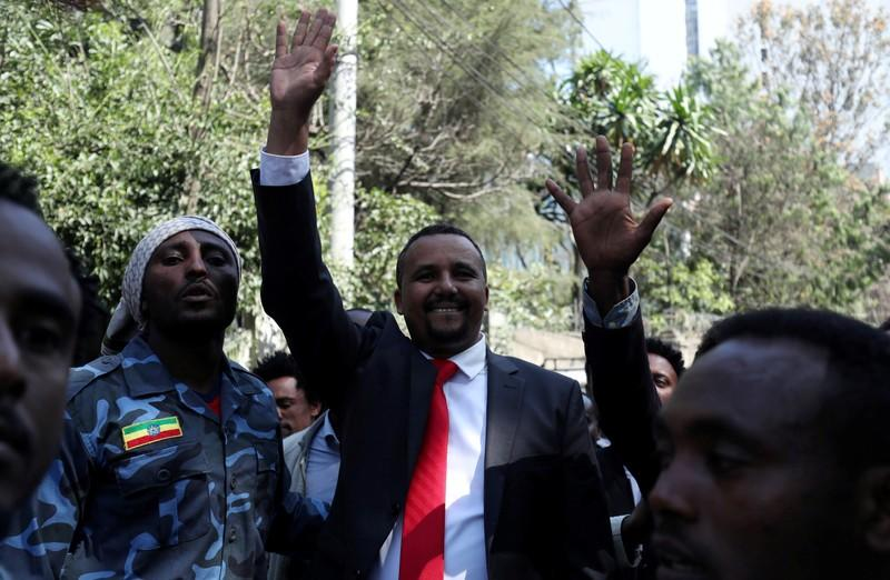 FILE PHOTO: Jawar Mohammed, an Oromo activist, waves to supporters outside his house in Addis Ababa