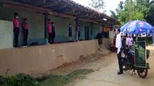COVID-19: With black board strapped to bike, Chhattisgarh teacher conducts 'mohalla' classes to educate children
