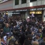 Thousands of protesters throng streets of Hong Kong as government urges calm