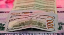 Dollar holds gains after U.S. jobs data, but off highs due to wages