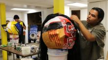 Young Indigenous artists paint their stories on big paper heads