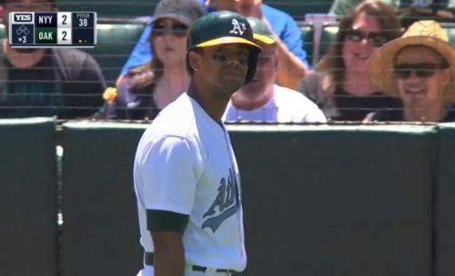 Khris Davis walks to the dugout following his embarrassing blunder against the Yankees. (MLB.TV)