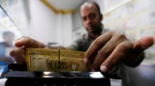 Sri Lanka rupee hits record low after Moody's downgrade, IMF loan delay