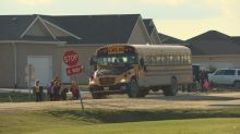 Dad's video of school bus driver dropping kids off in ditch prompts change