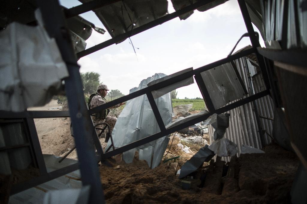 A Palestinian militant of the Islamic Jihad movement inspects rubble of a makeshift dwelling on August 22, 2016 in Beit Lahia in the northern Gaza Strip, following an Israeli airstrike the day before that targeted Hamas positions in the Gaza Strip (AFP Photo/Mahmud Hams)