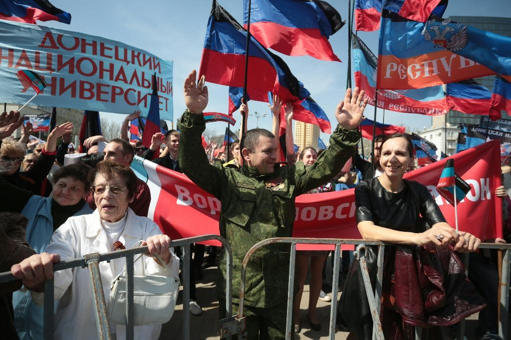 People shout slogans in the center of the eastern Ukrainian city of Donetsk on April 9, 2016 as they mark the second anniversary of the proclamation of the so called People's Republic of Donetsk (AFP Photo/Aleksey Filippov)