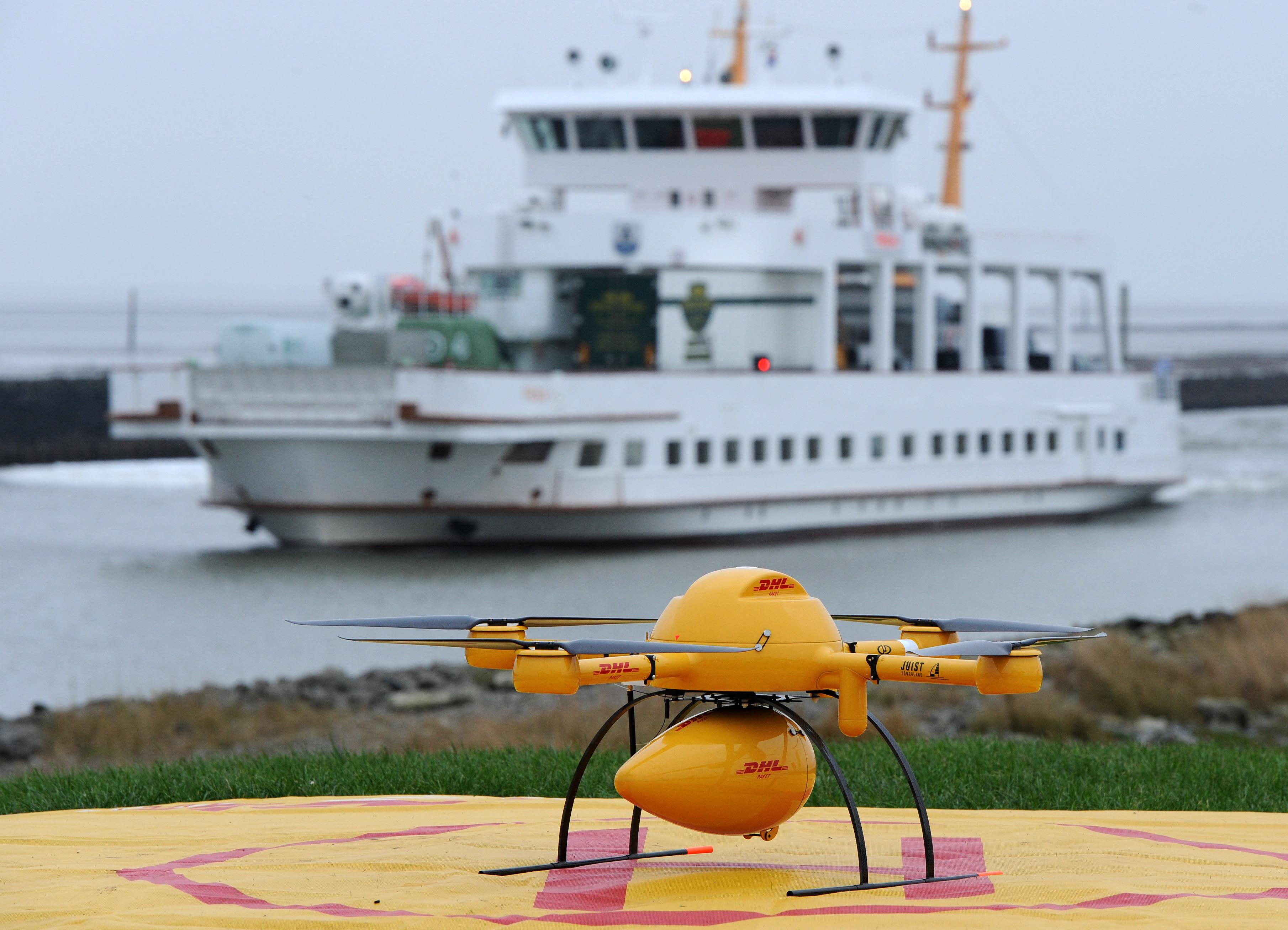 A quadrocopter remotely controlled DHL drone transporting medicines is pictured on November 18, 2014 in Norden-Norddeich, Gernmany (AFP Photo/Ingo Wagner)