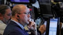 U.S. shares edge higher as healthcare vote eyed; gold dips