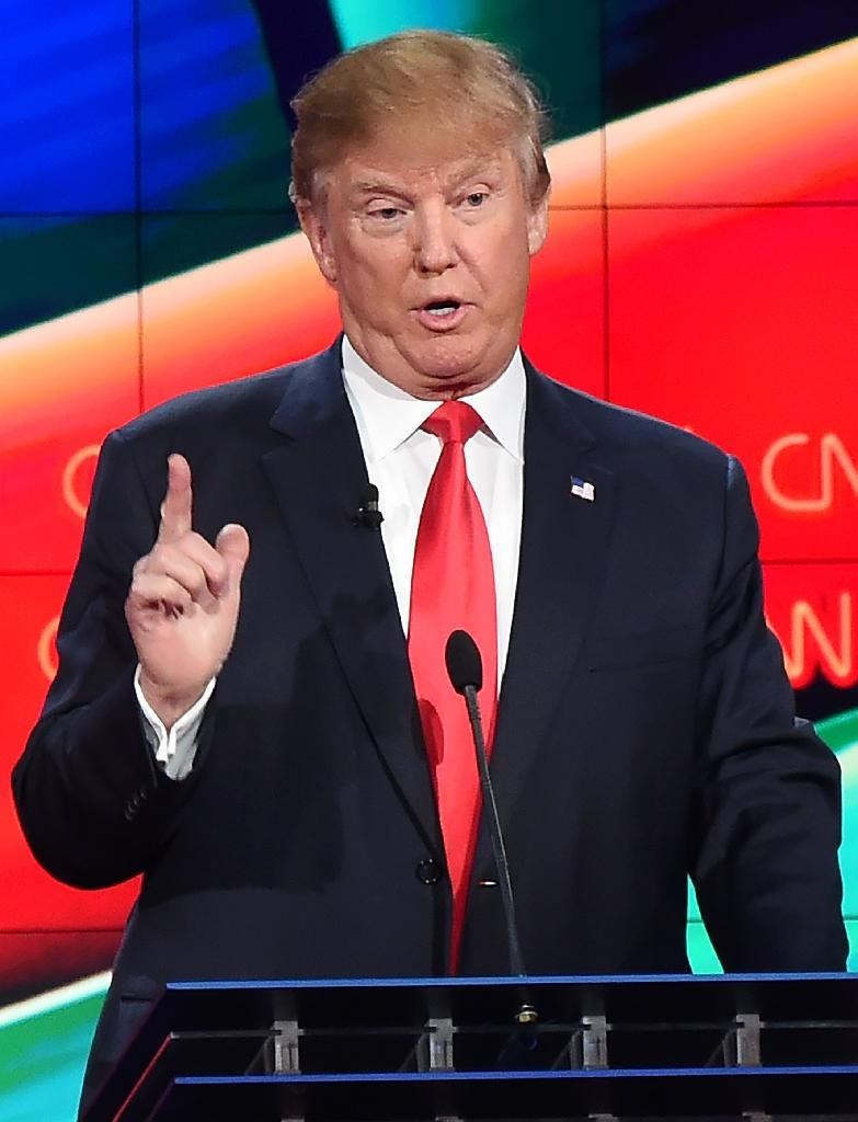 Donald Trump speaks in the Republican presidential debate hosted by CNN in Las Vegas on December 15, 2015 (AFP Photo/Robyn Beck)