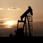 Oil rises 4% as OPEC+ works on output cut deal