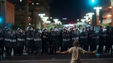 Police fire pepper spray to disperse protesters outside Trump rally in Phoenix