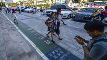 Chinesische Stadt Xi'an eröffnet eigene Spur für Smartphone-Nutzer