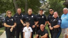 Boy, 8, with brain tumor raised thousands of dollars for police. What they did to return the favor will make you smile.