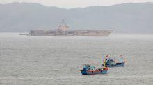 U.S. Navy relieves commander of coronavirus-stricken aircraft carrier