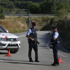 The Latest: Spain says man slain by cops was terror driver