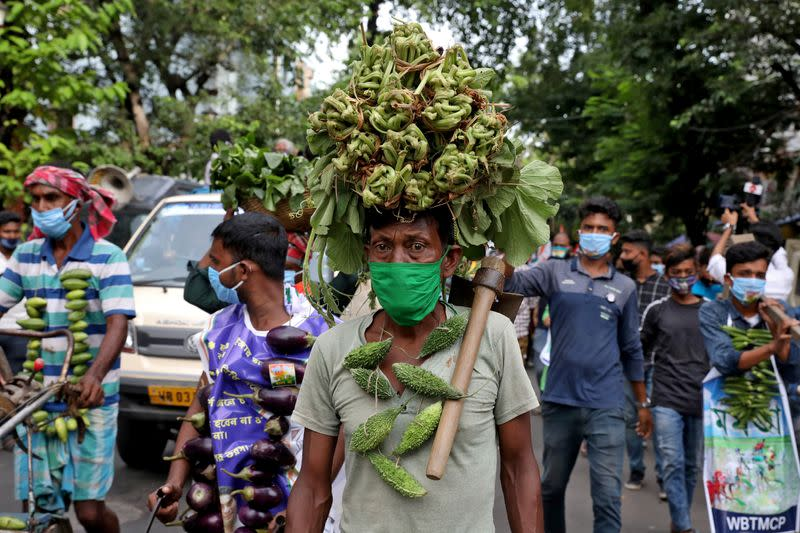 Farmers wearing vegetable garlands attend a protest march against farm bills passed by India's parliament, in Kolkata