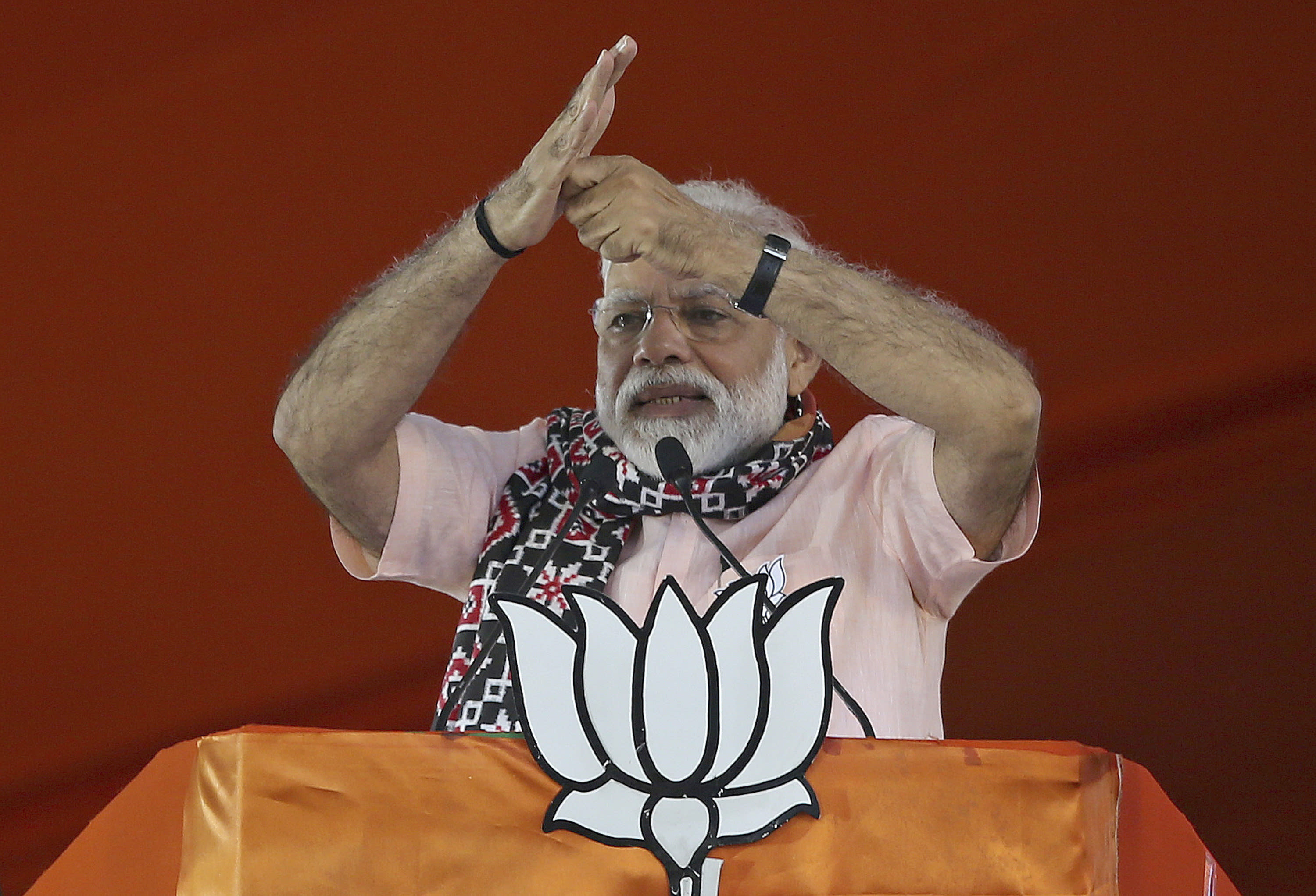"FILE - In this April 1, 2019, file photo, Indian Prime Minister Narendra Modi gestures as he speaks during an election campaign rally of his Bharatiya Janata Party (BJP) in Hyderabad, India. Modi has promised early elections in the Indian-controlled portion of Kashmir days after stripping it of statehood and turning it into a federally administered territory. In an address to the nation late Thursday, Aug. 8, Modi said the change in Kashmir's set-up will help free the disputed region of ""terrorism and separatism"" and put it on a path of development. (AP Photo/Mahesh Kumar A., File)"
