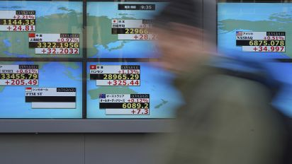 Asia stocks slightly up after Fed move