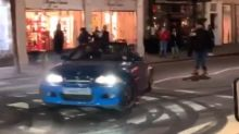 Footage shows a number of expensive cars performing doughnuts in London's Belgravia