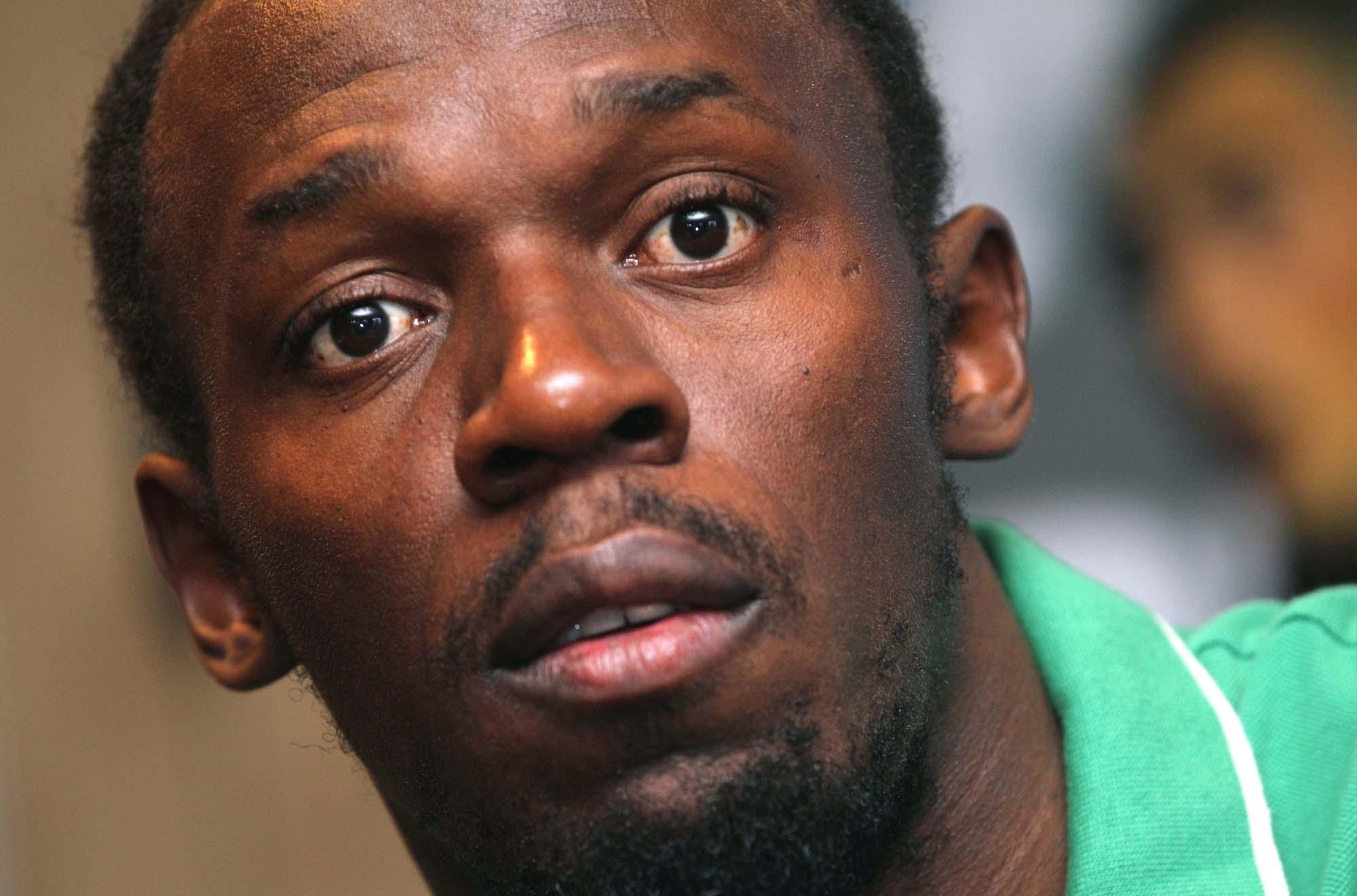 Athlete Usain Bolt of Jamaica addresses the media at the Sheraton hotel in Brussels on Wednesday, Sept. 4, 2013. Bolt arrived in Brussels to participate in the Diamond League Memorial Van Damme Track and Field meeting on Friday. (AP Photo/Yves Logghe)
