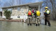 Cut off by water, Quebec island residents determined to stay in their homes