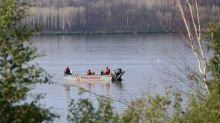 Searchers scour lake near Fort McMurray for adult male