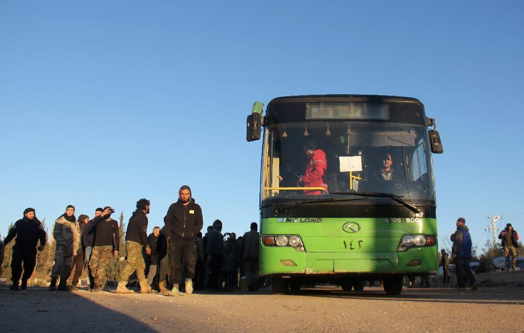 Syrians who were evacuated from rebel-held neighbourhoods in Aleppo arrive in the opposition-controlled Khan al-Aassal region on December 15, 2016 (AFP Photo/Omar haj kadour)