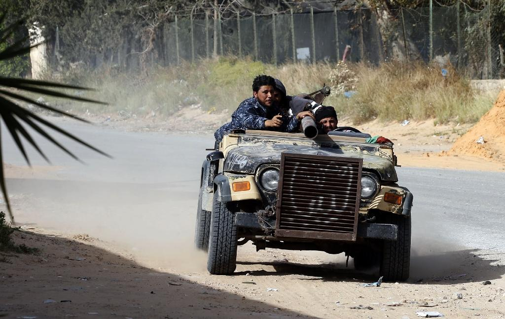 Libyan fighters loyal to the Government of National Accord drive a jeep mounted with a heavy weapon during clashes with strongman Khalifa Haftar's forces south of Tripoli on Saturday (AFP Photo/Mahmud TURKIA)