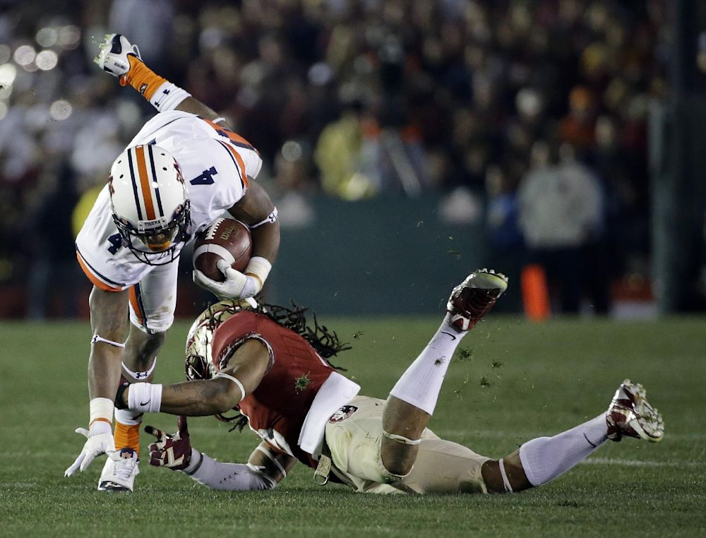 Florida State's Ronald Darby trips up Auburn's Quan Bray (4) after a catch during the second half of the NCAA BCS National Championship college football game Monday, Jan. 6, 2014, in Pasadena, Calif