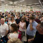 Anxious Thomas Cook passengers seek a way home to Britain