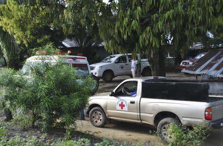 Medical vehicles are seen at a health facility near the Liberia-Sierra Leone border in western Liberia