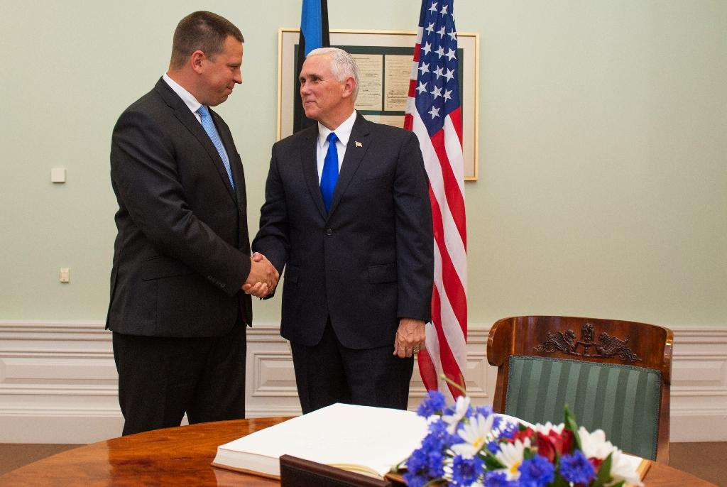 Estonia's Prime Minister Juri Ratas (L) shakes hands with US Vice President Mike Pence prior talks in Tallinn, Estonia on July 30, 2017